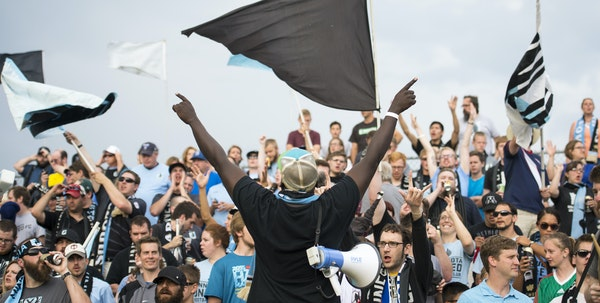 The Dark Clouds – the loud and loyal supporters of Minnesota United FC, shown above being led by Abraham Opoti, center – are ready to follow their