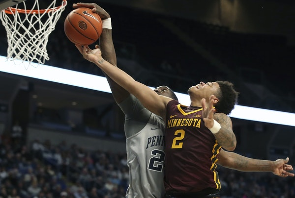 Gophers guard Nate Mason had his shot blocked by Penn State's Mike Watkins, part of a 52-50 loss and a pair of defeats that interrupted a run of Gop