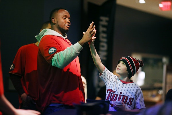 Ten-year-old Jackson Roethler found Twins slugger Miguel Sano to be a handful, and then some, during fan activities on the last day of TwinsFest 2016.