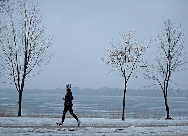 A runner made her way early Monday around Lake Calhoun, where runners generally enjoy cleared paths.