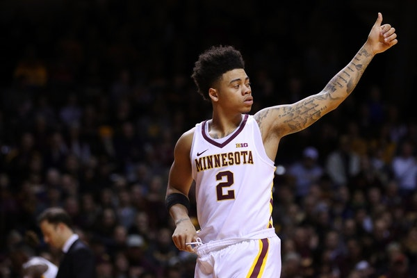 Minnesota Golden Gophers guard Nate Mason (2) gestures to his teammates after entering the game during the first half.