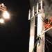 Rescue personnel bring down 1 of 3 workers from a water tower in Golden Valley.