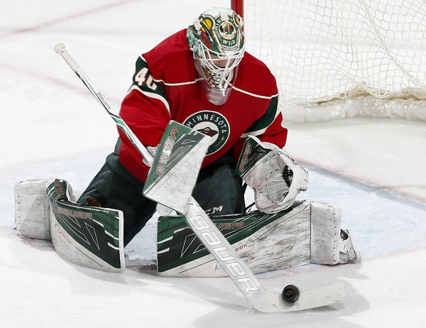 Wild goalie Devan Dubnyk (40) made a save against the Colorado Avalance in the third period at Xcel Energy Center.