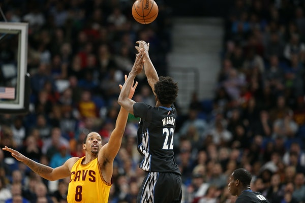 Minnesota Timberwolves forward Andrew Wiggins (22) shoots a 3-pointer over Cleveland Cavaliers forward Channing Frye (8) in the second half at Target