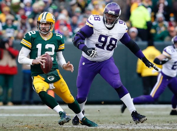 Vikings nose tackle Linval Joseph chased Packers quarterback Aaron Rodgers.