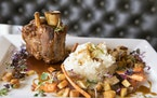 The crackling pork shank with roasted root vegetables, Granny Smith apples and cider demi-glace at McKinney Roe.