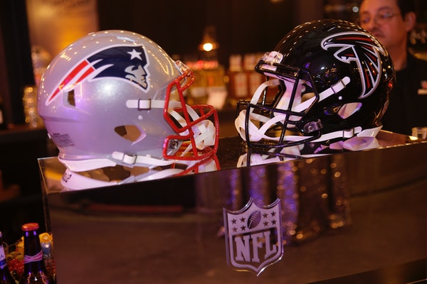 IMAGE DISTRIBUTED FOR NFL - New England Patriots and Atlanta Falcons football helmets are on display during the NFL Media Super Bowl party at Chapman