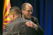 U.S. Secretary of Labor Tom Perez, right, a candidate for the Democratic National Committee chair hugs U.S. Representative Keith Ellison, MN-5, also a