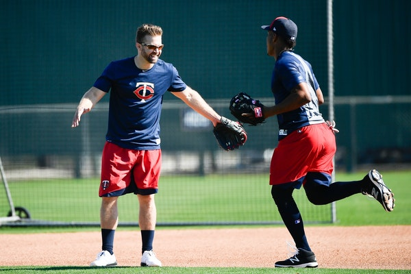 Minnesota Twins second baseman Brian Dozier (2) greeted infielder Jorge Polanco Friday on one of the practice fields at CenturyLink Sports Complex.