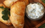 Empanadas with a cheese and veggie filling.