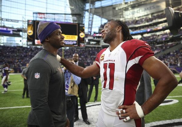 Injured Vikings running back Adrian Peterson said hello to Arizona Cardinals wide receiver and Minneapolis native Larry Fitzgerald in November at U.S.