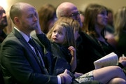 Brian Muller was comforted by daughter EmmyLu as he bid farewell to his wife at her funeral services Friday.