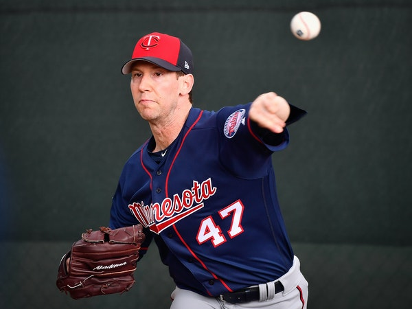 Twins relief pitcher Craig Breslow (47) threw the ball in the bullpen during spring training workouts.