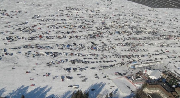 This aerial photo shows vehicles and fish houses on the ice at the 2012 International Eelpout Festival in Walker, Minn.