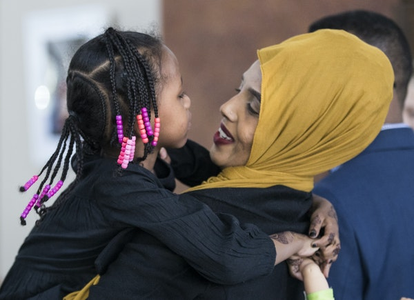 Mushkaad Abdi, 4, held tight to her mother, Samira Dahir, after Friday's news conference in Minneapolis at Lutheran Social Service.