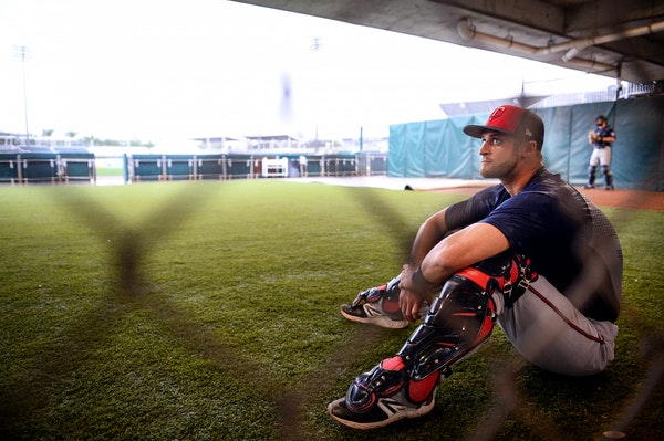 Minnesota Twins catcher Dan Rohlfing (78) sat in the bullpen while waiting for his chance to catch Wednesday morning.