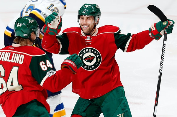 Mikael Granlund (64) and Jason Zucker (16) celebrated a goal by Granlund in the third period.
