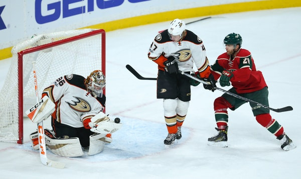 Ducks goalie John Gibson (36) made a second period save before either Anaheim defenseman Hampus Lindholm (47) or Wild right wing Jason Pominville (29)