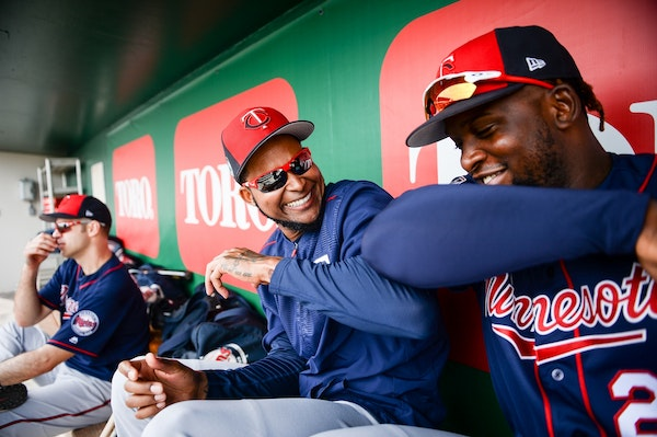 Twins starting pitcher Ervin Santana (54) and third baseman Miguel Sano (22) joked around in the dugout at spring training.