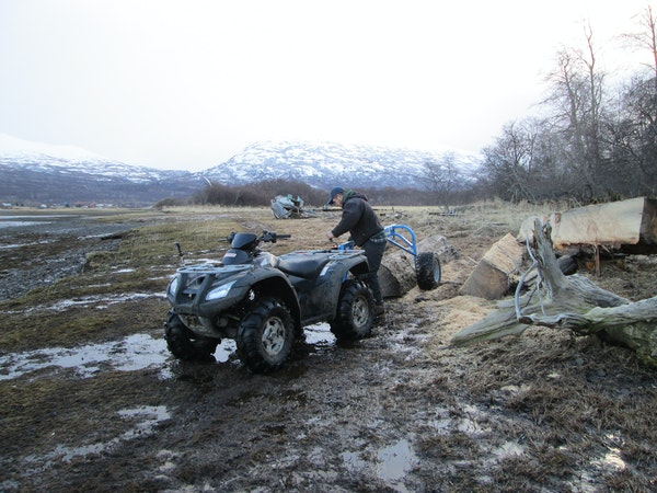 "Builder Nick Blanco attached a log to his ATV in Larsen Bay, Alaska, as seen on DIY Network's ""Building Alaska."""