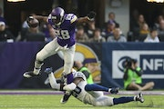 Vikings running back Adrian Peterson tried to step out of a tackle by Indianapolis Colts free safety Darius Butler ( after catching a pass for a one y