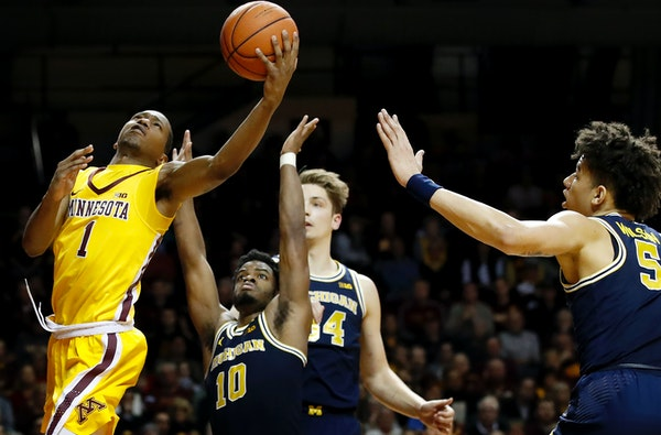 Dupree McBrayer combined with Eric Curry for 27 points in the Gophers' 83-78 victory over Michigan on Sunday.