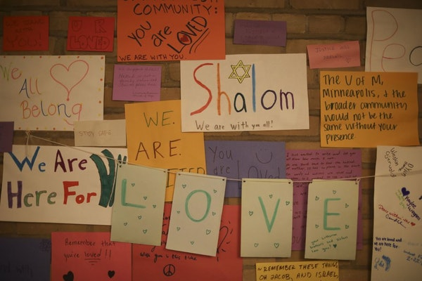 Some of the signs that supporters, including at group from the U's Lutheran Campus Ministry, put up on a wall in the lobby of Minnesota Hillel on Thur