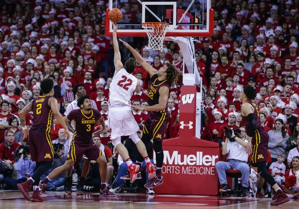 Wisconsin's Ethan Happ (22) shots against the Gophers' Reggie Lynch during the Badgers' 66-49 victory Sunday in Madison, Wis.