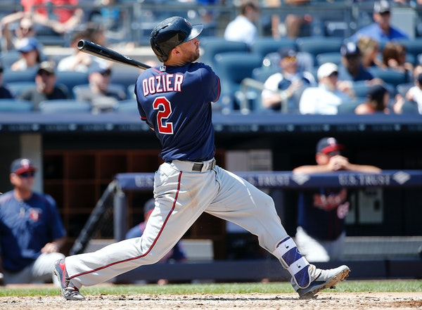 Brian Dozier (2) hit his first home run of spring training on Friday.