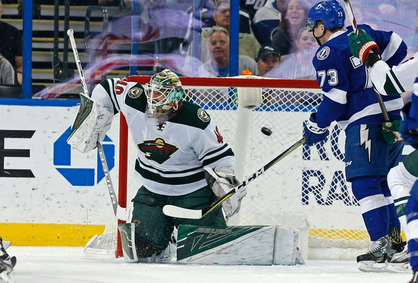 Minnesota Wild goalie Devan Dubnyk allows a goal to Tampa Bay Lightning's Victor Hedman as Adam Erne (73) looks on during the first period of an NHL h