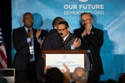 Thomas Perez, the former labor secretary, hugged Rep. Keith Ellison of Minnesota at the Democratic National Committee's winter meeting in Atlanta on S
