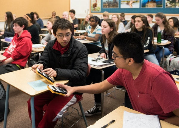 Richfield tenth-graders Kenny Tran and Caleb Sotl compared results during their pre-calculus class. Richfield High School has seen an increase in grad
