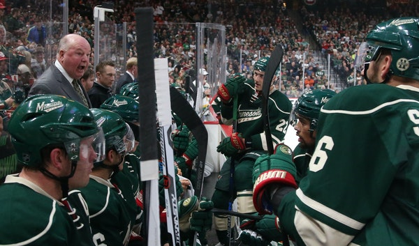 Coach Bruce Boudreau, left, said the assignments under his coaching system haven't completely sunk in with Wild players.