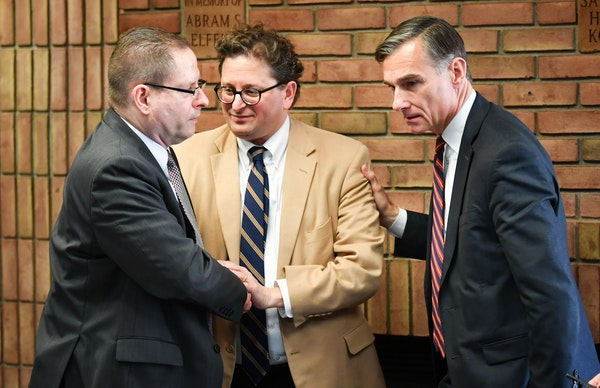 Steve Hunegs, center, executive director of the Jewish Community Relations Council, thanked FBI agent Richard Thornton, left, and Greg Brooker, acting