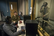 From left, Kevin Lee, Emily Pauly and Josh Groven recorded a rap song in the studio at the School for Environmental Studies on Tuesday. Pauly launched
