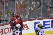 Capitals center Jay Beagle (83) celebrated his goal with left wing Daniel Winnik as Wild defensemen Jared Spurgeon (46) and Ryan Suter skated by durin