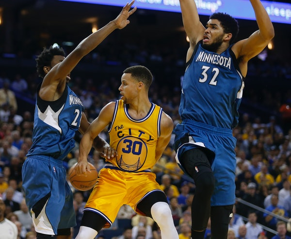 The Wolves' Andrew Wiggins (left) and Karl-Anthony Towns (right) -- shown guarding Golden State's Stephen Curry in an April 2016 game -- have set fran