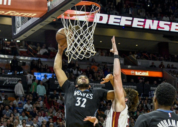 Karl-Anthony Towns went in for two of his 31 points against Miami's Hassan Whiteside on Friday night.