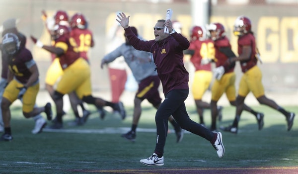 Gopher coach P.J. Fleck sprinted down the field with his team during football practice at the University of Minnesota Tuesday March 21, 2017 in Minnea