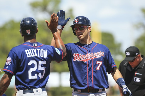 The Twins' Byron Buxton high-fived Joe Mauer after Mauer hit his first home run of the spring in his team's final game against a big-league team.