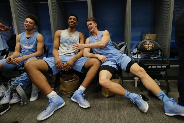 From left, North Carolina's Shea Rush, Tony Bradley and Aaron Rohlman had some fun after a Final Four practice Thursday.