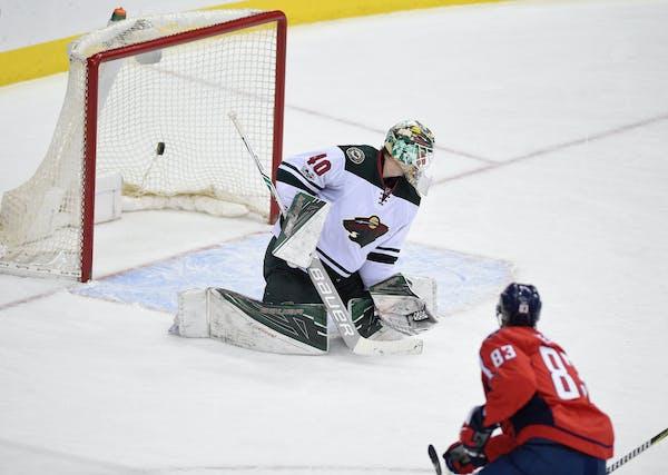 Washington Capitals center Jay Beagle (83) scores a goal past Minnesota Wild goalie Devan Dubnyk (40) during the third period of an NHL hockey game, T