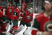 Wild goalie Alex Stalock skated off with his teammates after his first NHL victory in more than a year.