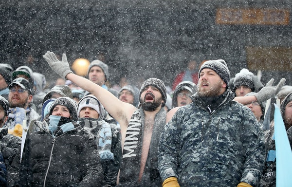 Minnesota United FC fans braved the cold and snow to cheer for the team during the first half as the Minnesota United FC took on Atlanta United at TCF
