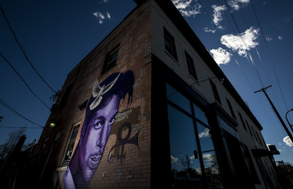 """A mural of Prince by local artist Rock """"Cyfi"""" Martinez on a building at 26th Street and Hennepin Avenue in Uptown Minneapolis."""