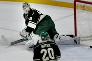 Wild goalie Devan Dubnyk and defenseman Ryan Suter could only watch the aftermath of T.J. Oshie's overtime winner.