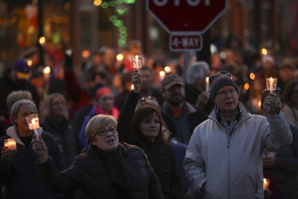 """The crowd joined together to sing """"This Little Light of Mine"""" at the conclusion of the vigil Sunday night in Delano."""
