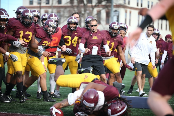 Gophers head coach P.J. Fleck reacted with his team during spring practice one on one drills