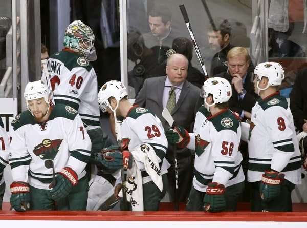 Minnesota Wild goalie Devan Dubnyk (40) leaves the game after giving up two goals during the first period of an NHL hockey game against the Chicago Bl