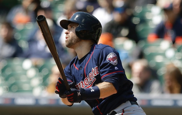 The Twins' Brian Dozier watched his solo home run off Tigers starter Michael Fulmer in the game's first at-bat Wednesday.